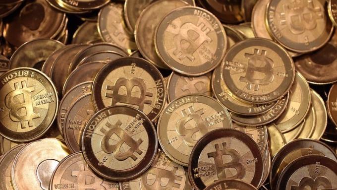 比特幣又傳出遭駭被盜。(圖:AFP)