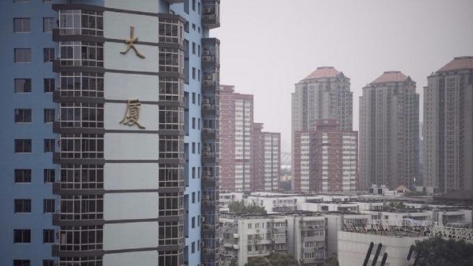 專家認為2018年中國樓市平穩調整。(圖:AFP)