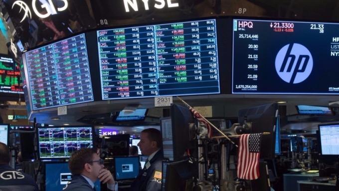 圖:AFP 美國股市週二中場漲跌互見