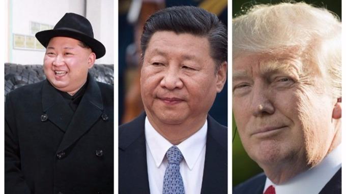習近平(中)、川普(右)、金正恩(左)打進《時代》風雲人物前10強。 (圖:AFP)