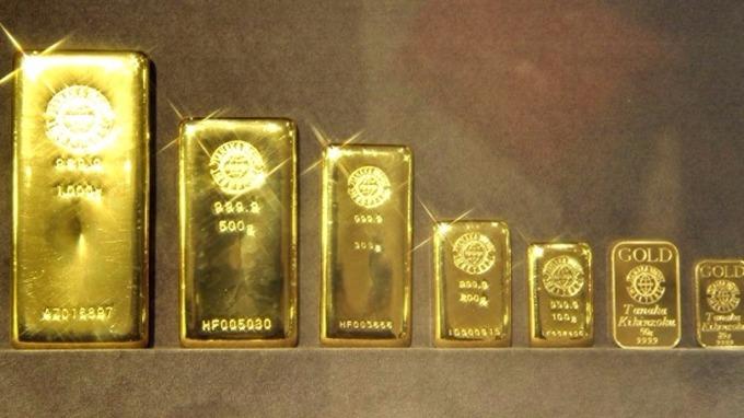 現貨黃金跌向1260美元8盎司關口,200日關鍵均線失守。 (圖:AFP)