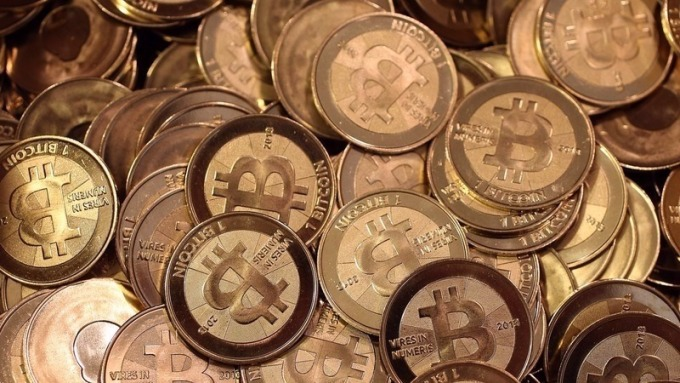 比特幣新高之際 黃金、白銀遭遇拋售風暴。(AFP)