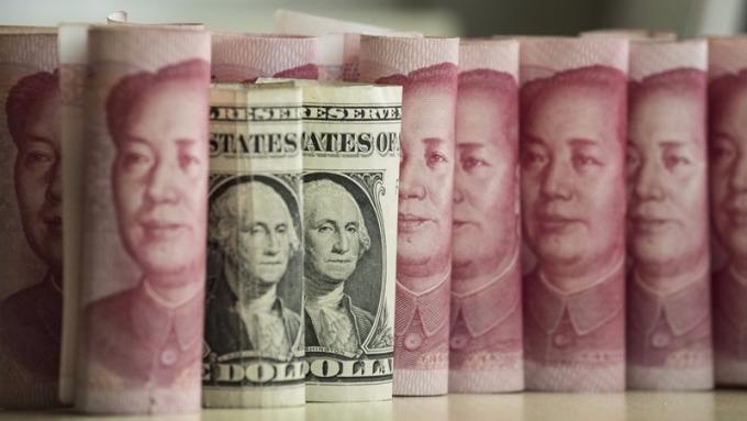 11月中國外儲3.1193兆美元,連續第10個月出現回升。 (圖:AFP)