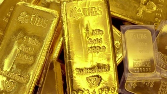 COMEX黃金期貨合約週五(5日)凌晨3:33一分鐘內成交量為5283手,交易合約總價值近7億美元。 (圖:AFP)