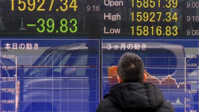 日元走高。(AFP)