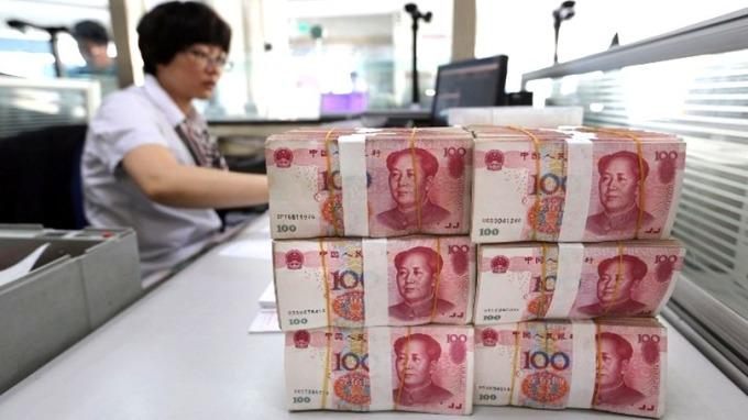 人民幣最高重返6.5水平。 (圖:AFP)