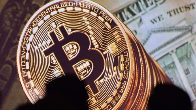 比特幣和以太幣們隱藏着真正的「壟斷」。(圖:AFP)
