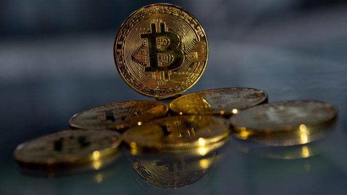 比特幣已是區塊鏈最著名的應用(圖:AFP)