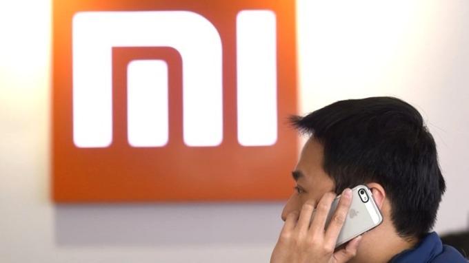 雷軍表示,在10季內重奪中國市場一哥地位。 (圖:AFP)