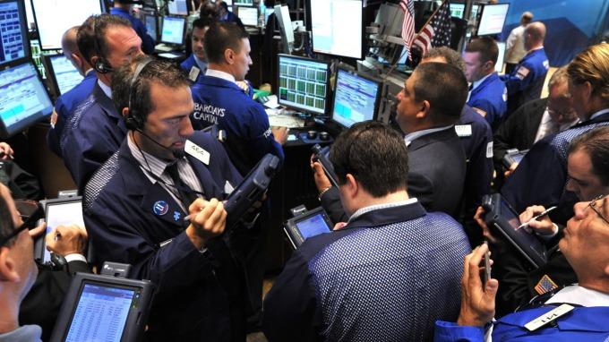 圖:AFP  分析師警告美國股市恐將進一步走低