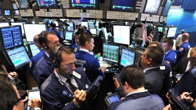 圖:AFP  美國股市週四震盪 終場收高