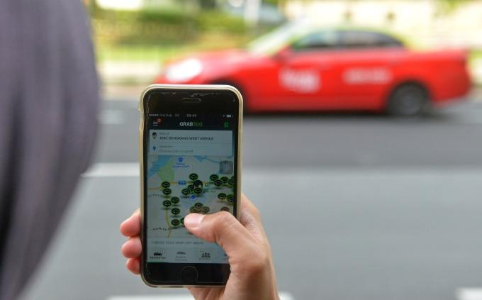 Lyft賺錢速度比較快,但沒有Uber賺得多      (圖:AFP)
