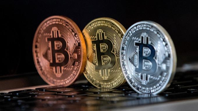 比特幣等加密資產,恐危害金融穩定。(圖:AFP)