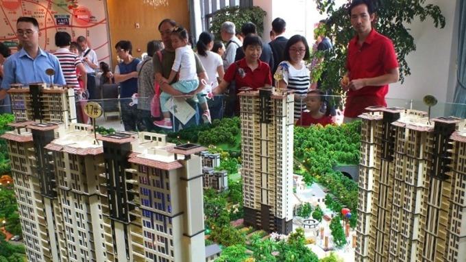 李稻葵表示,房價一年上漲20-30%的景象難以再現。 (圖:AFP)