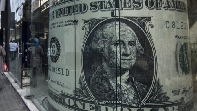 圖:AFP  美元週一下跌
