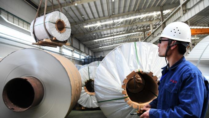 這個交易商趁低價囤鋁賺翻了。(AFP)
