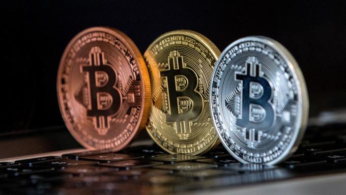 投資公司宣稱,比特幣可望漲至6.4萬美元。(圖:AFP)