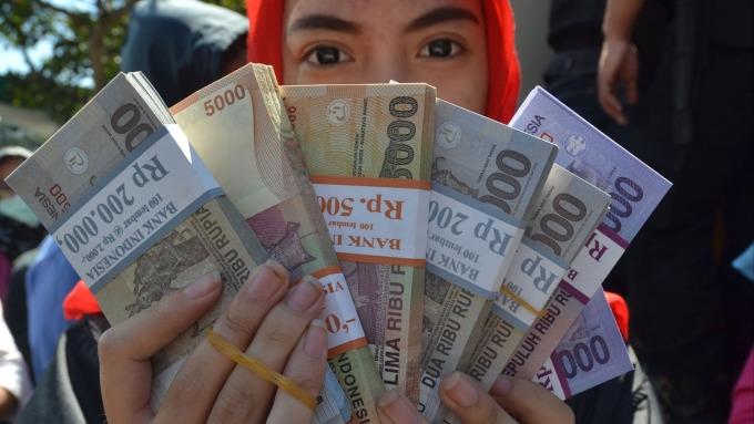 印尼盾極易受利率上升影響      (圖:AFP)