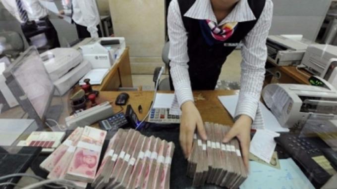 去槓桿政策下,中國企業發行海外債今年以來發債擴增近2倍。(圖:AFP)