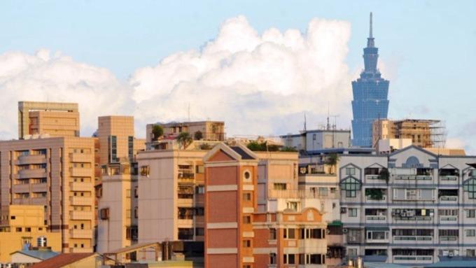 房市景氣回溫,合庫銀今年拚房貸餘額年成長3%。(圖:AFP)