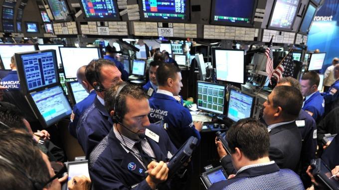 圖:AFP  美國股市週五下跌 但Nasdaq小幅收高