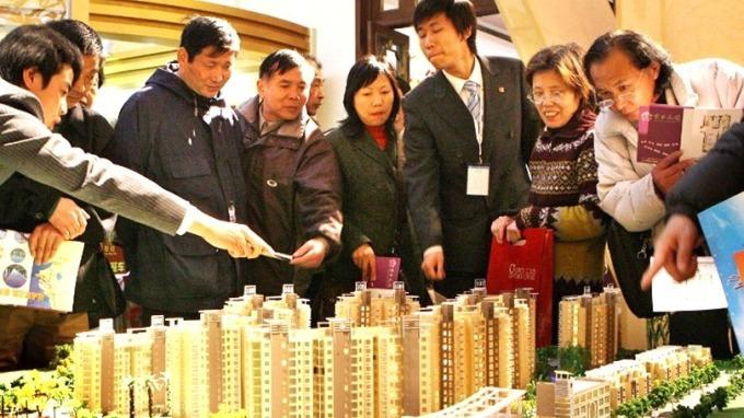 中國百強房企前5月銷售規模達人民幣3.47兆元,年增33.5%。 (圖:AFP)