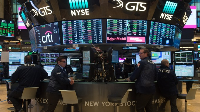 圖:AFP  美國股市週四收盤漲跌互見