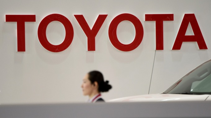 豐田10億美元投資叫車平台Grab。(圖:AFP)