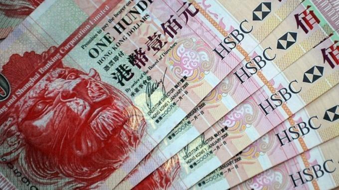 香港金管局今(14)日宣佈升息1碼後,短天期港元Hibor應聲回落。 (圖:AFP)