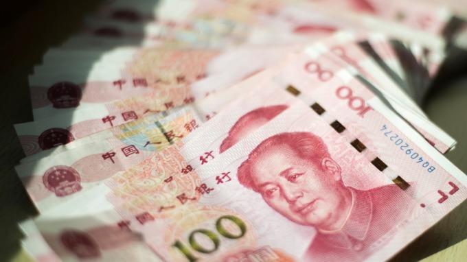 近期人民幣貶值不減外資持有中國境內債券資產的信心(圖:AFP)