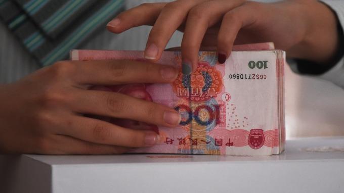人民幣中間價止跌回升報6.6259 升值134點(圖:AFP)