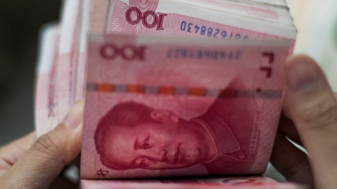 離岸人民幣一早急跌(圖:AFP)
