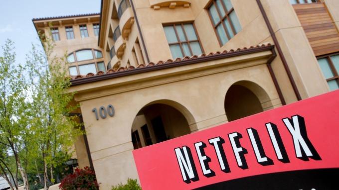 Netflix正瘋狂砸錢、大肆拼搶市場。(圖:AFP)