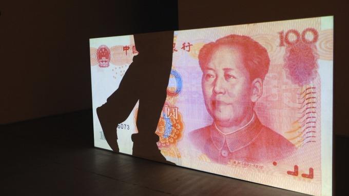 人民幣持續弱勢。(圖:AFP)