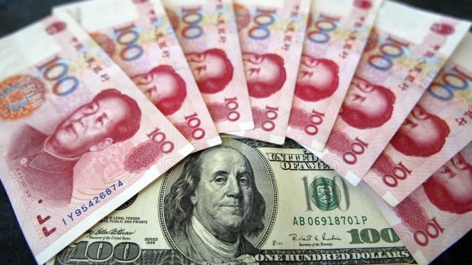 分析師:面對關稅攻勢,人行將默許人民幣走貶      (圖:AFP)