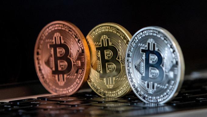 數位貨幣致力擴張規模。(圖:AFP)
