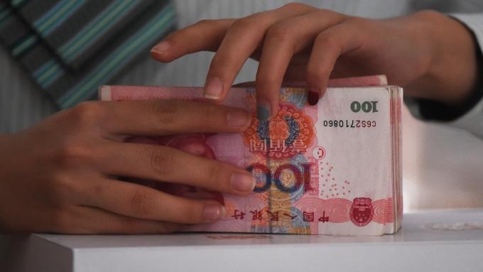中間價報6.6727貶值1個點(圖:AFP)