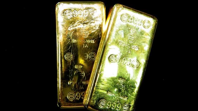 美元走強,金價下滑。(圖:AFP)