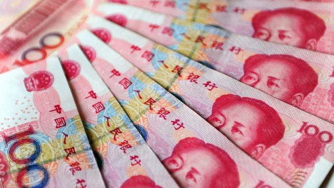 人民幣兌美元中間價報6.7066(圖:AFP)