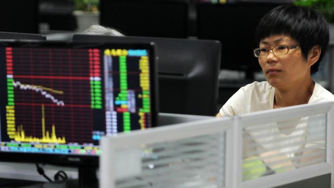 近來資金大舉轉進中國債市(圖:AFP)