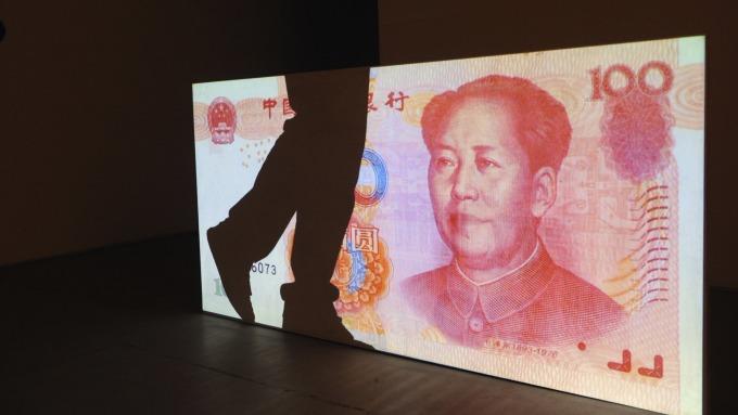 2018年以來,人民幣兌美元下跌約5%。(圖:AFP)