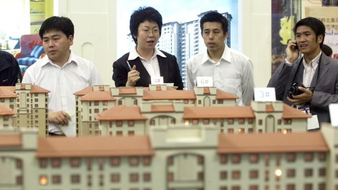 中國工行和農行調降上海首套房利率折扣(圖:AFP)