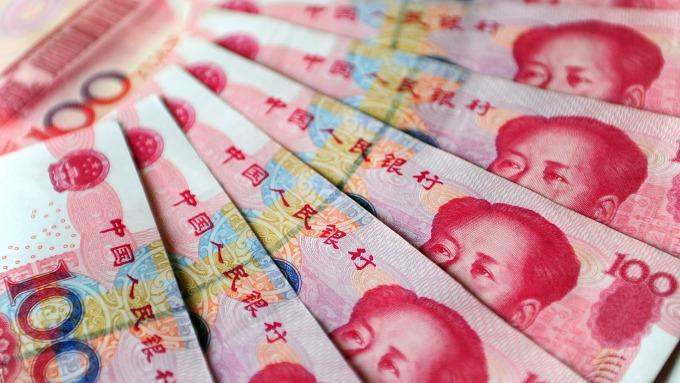 人民幣中間價報6.8894上調52點(圖:AFP)