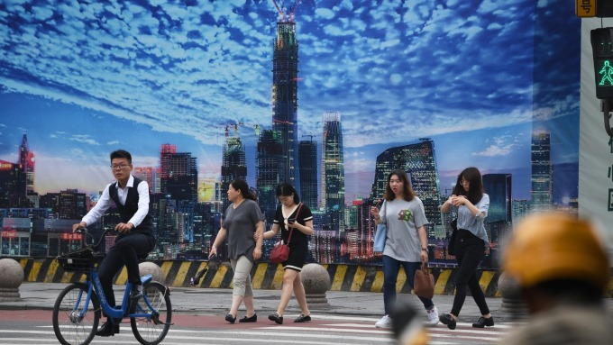 傳多地暫停新增地產信託報備(圖:AFP)