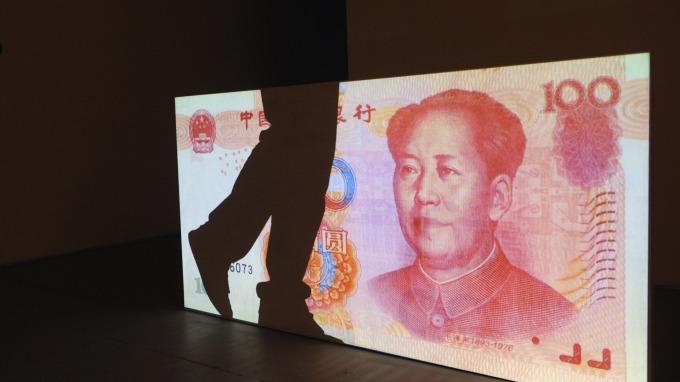人民幣兌美元走貶。(圖:AFP)