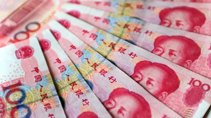 人民幣中間價上調58點(圖:AFP)