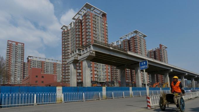 中國下一招很可能鎖定房地產,以拉抬房價來提振經濟。(圖:AFP)