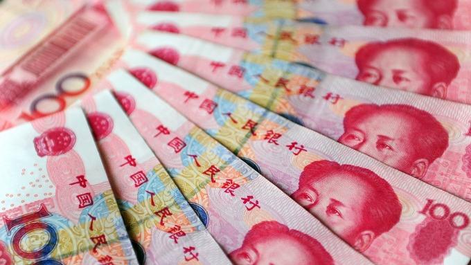 人民幣中間價報6.8362上調126點(圖:AFP)