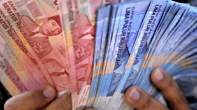 印尼盾貶破15000 。(圖:AFP)