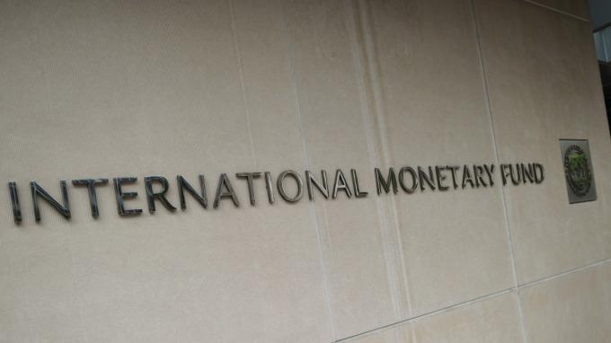 IMF下調全球經濟增速預期。(圖:AFP)